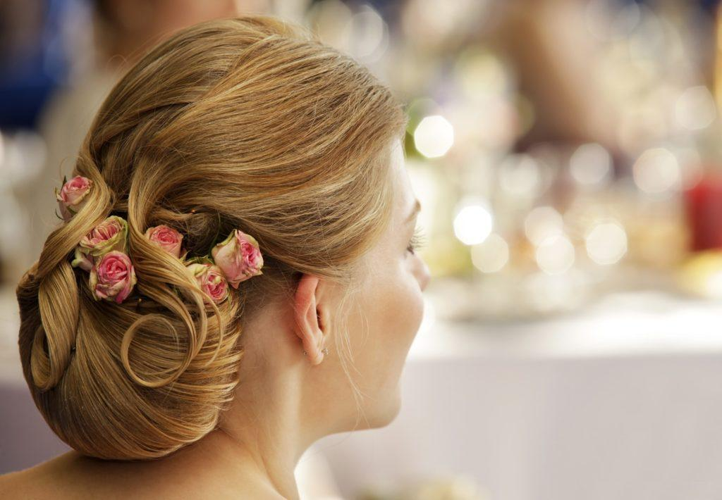 flower girl hairstyles styled updo flowers blonde