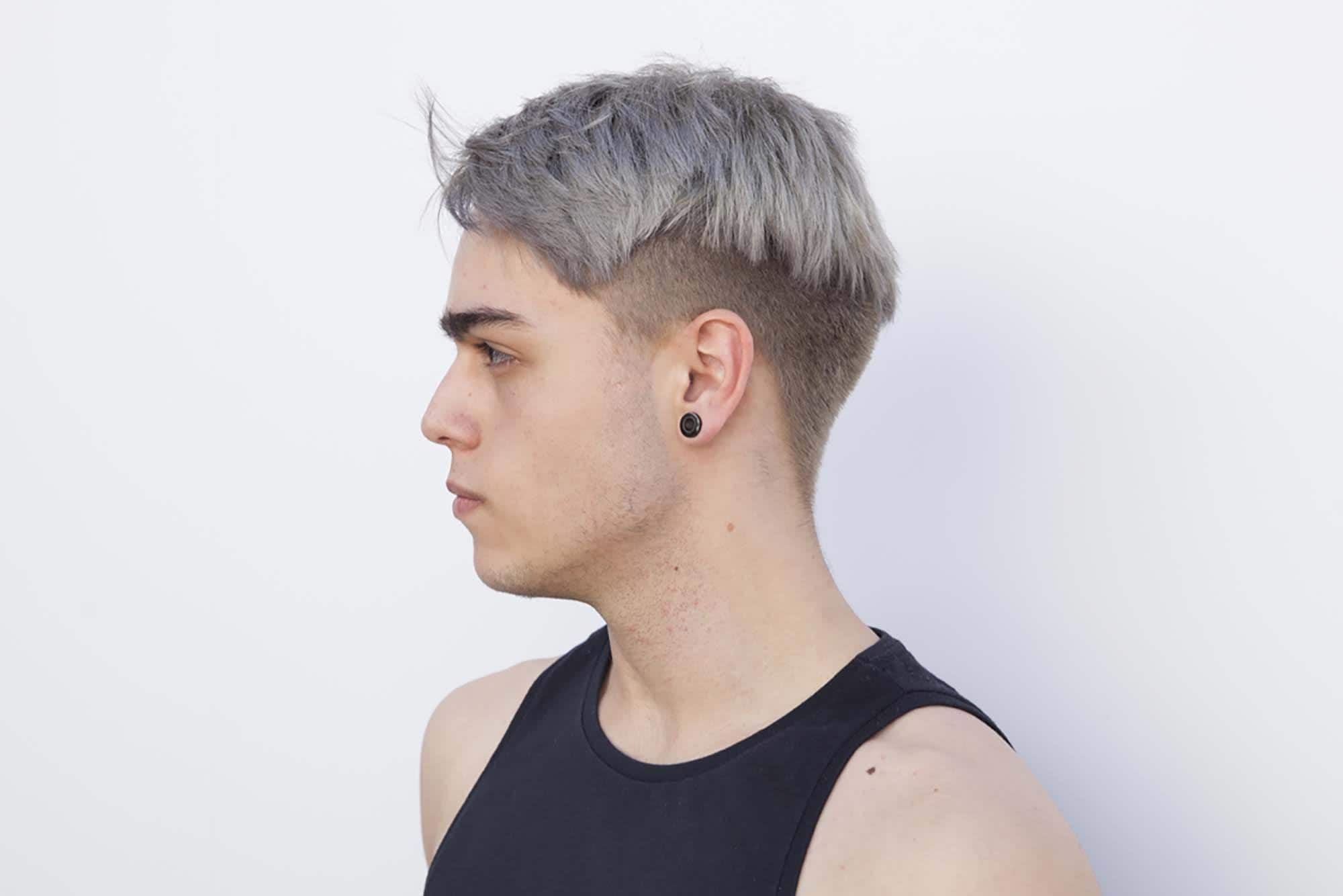 low-key undercut shaved sides hairstyles mens