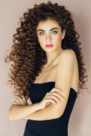 spiral perm long tight brown curls