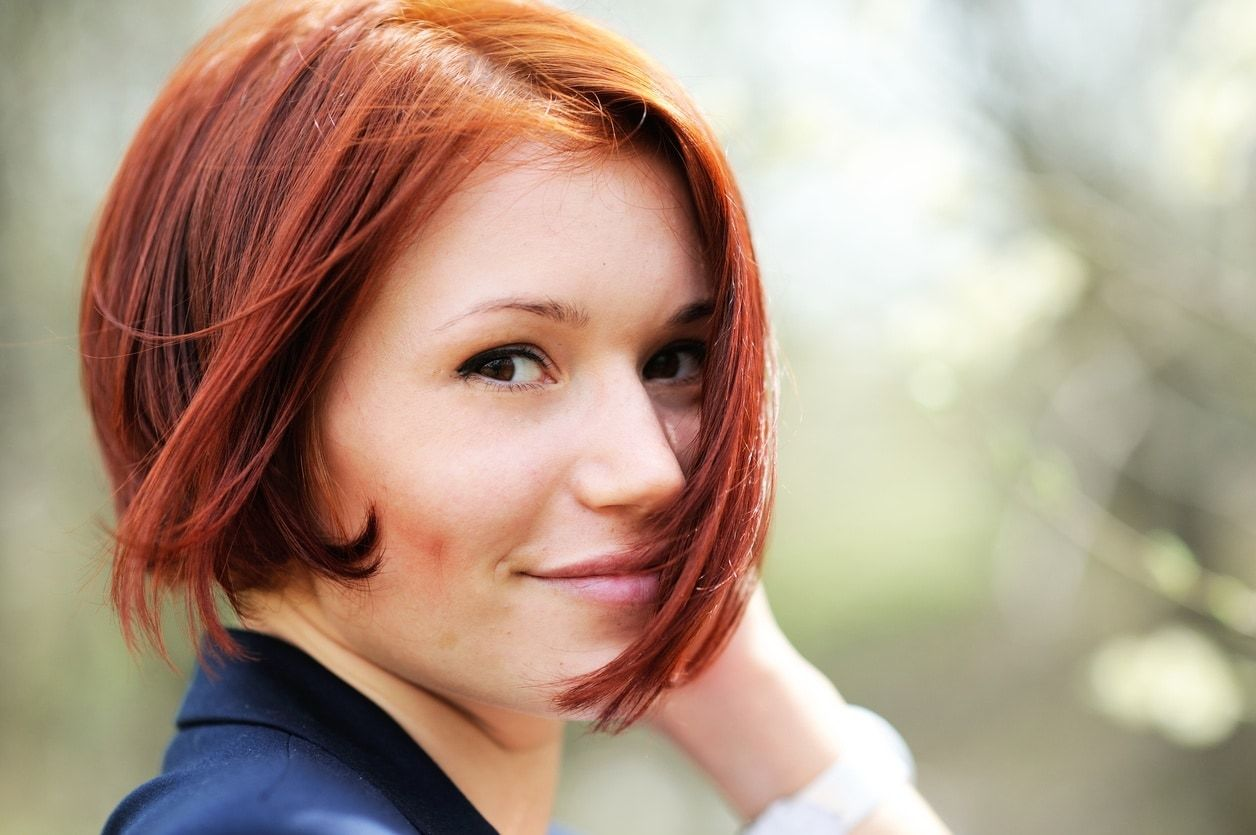 asymmetrical bob cinnamon hair color