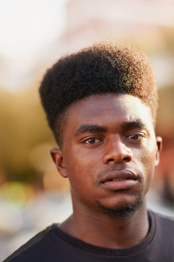 curly faux hawk high top fade