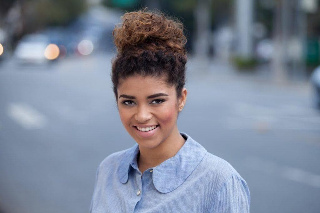 easy styles for curly hair top knot bun