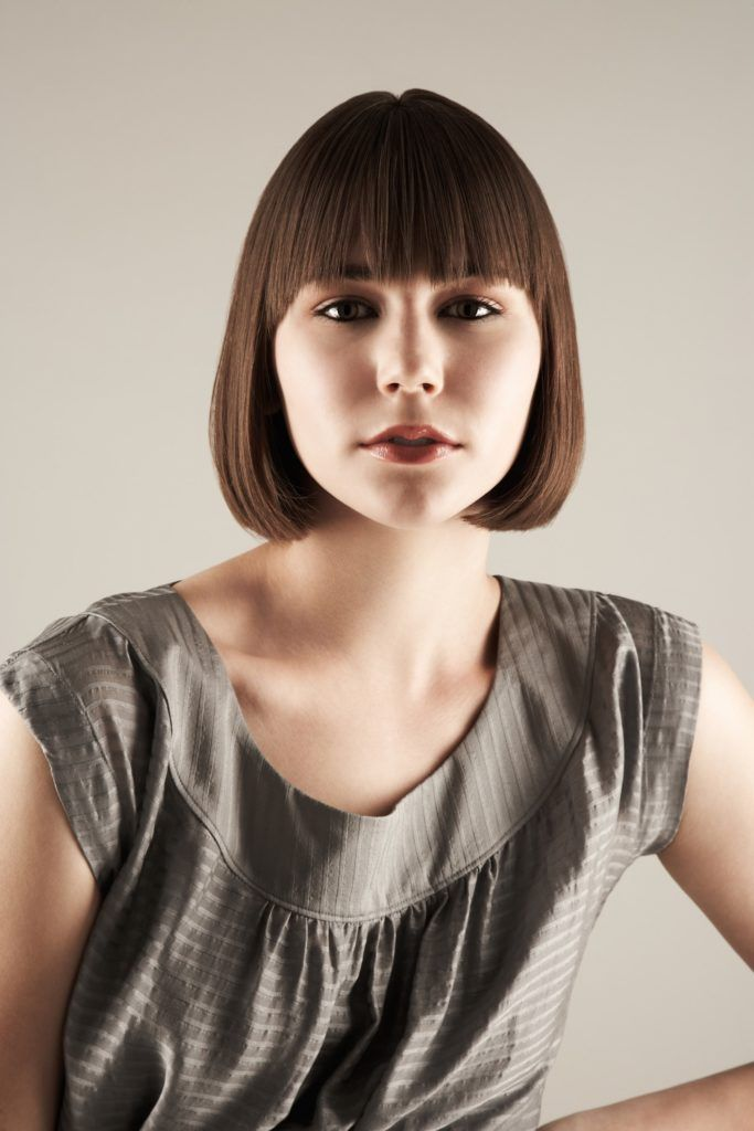 ways to style short hair with bangs bangs 18 trendy ways to wear this edgy style 3799 | short bangs sleek bob min 683x1024