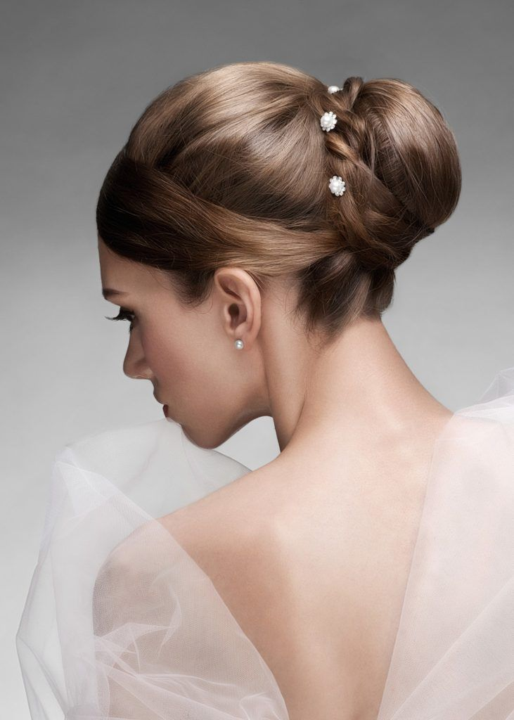 wedding updos for short hair sleek bun small flowers