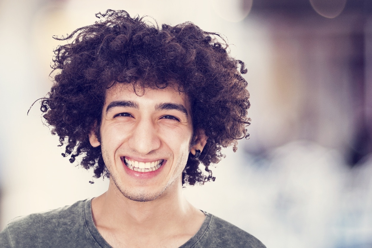 25 Hairstyles For Men With Thick Curly Hair