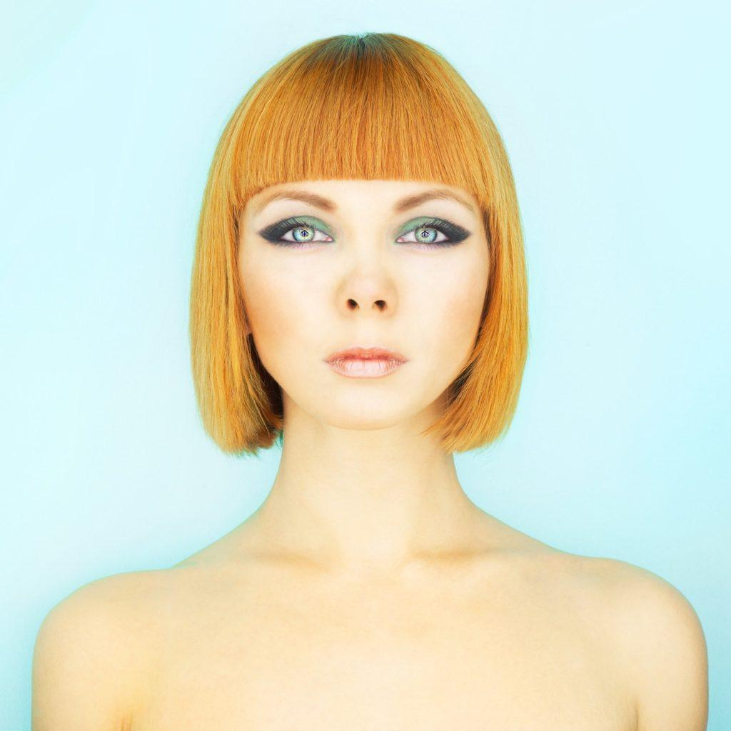 a line bob dark blunt bangs light red