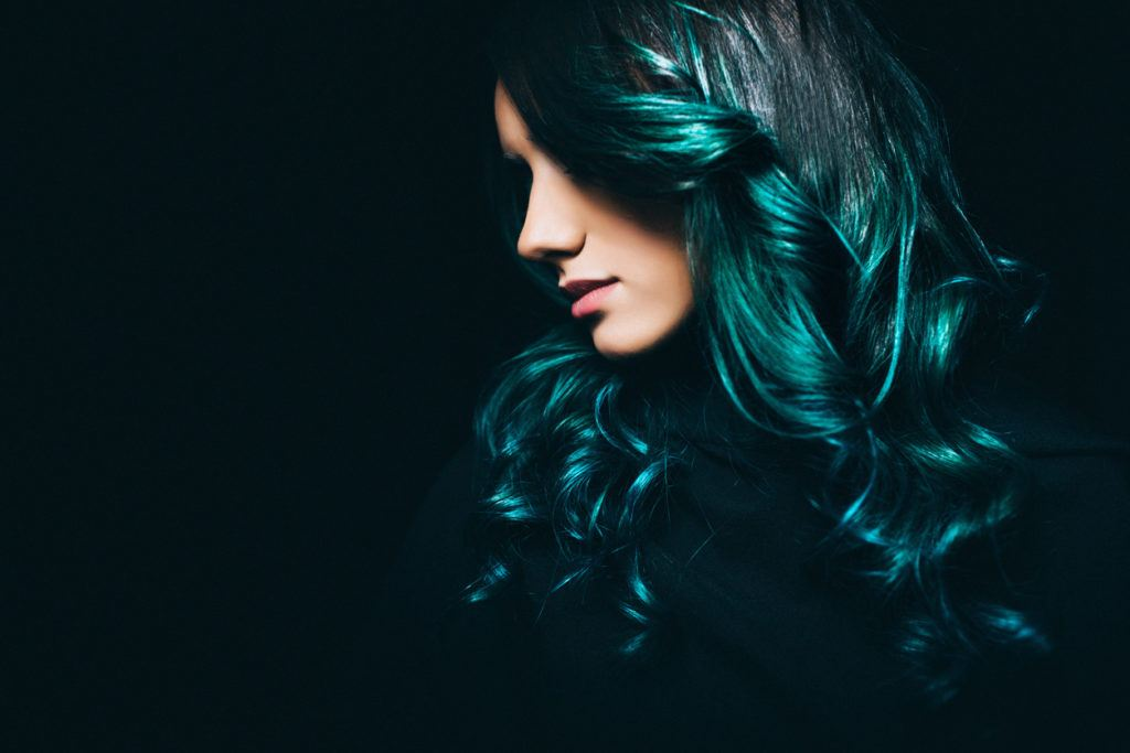 black hair with blue tips side swept bangs