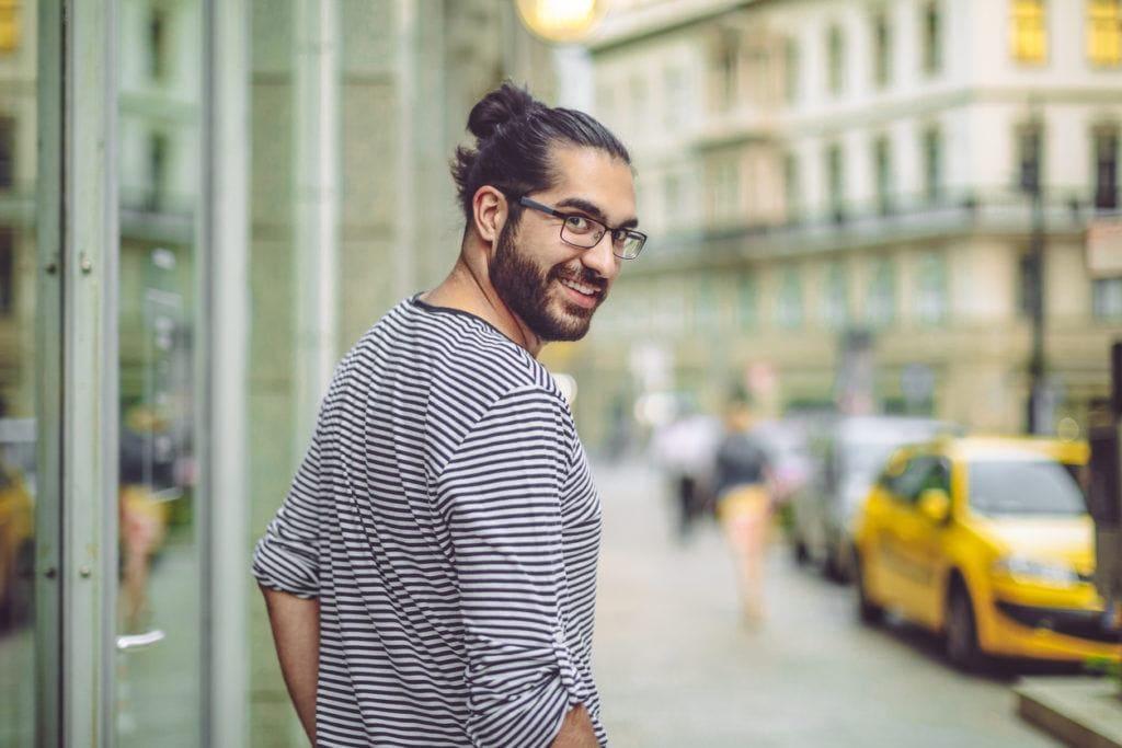 medium hairstyles for men with thick hair: man bun