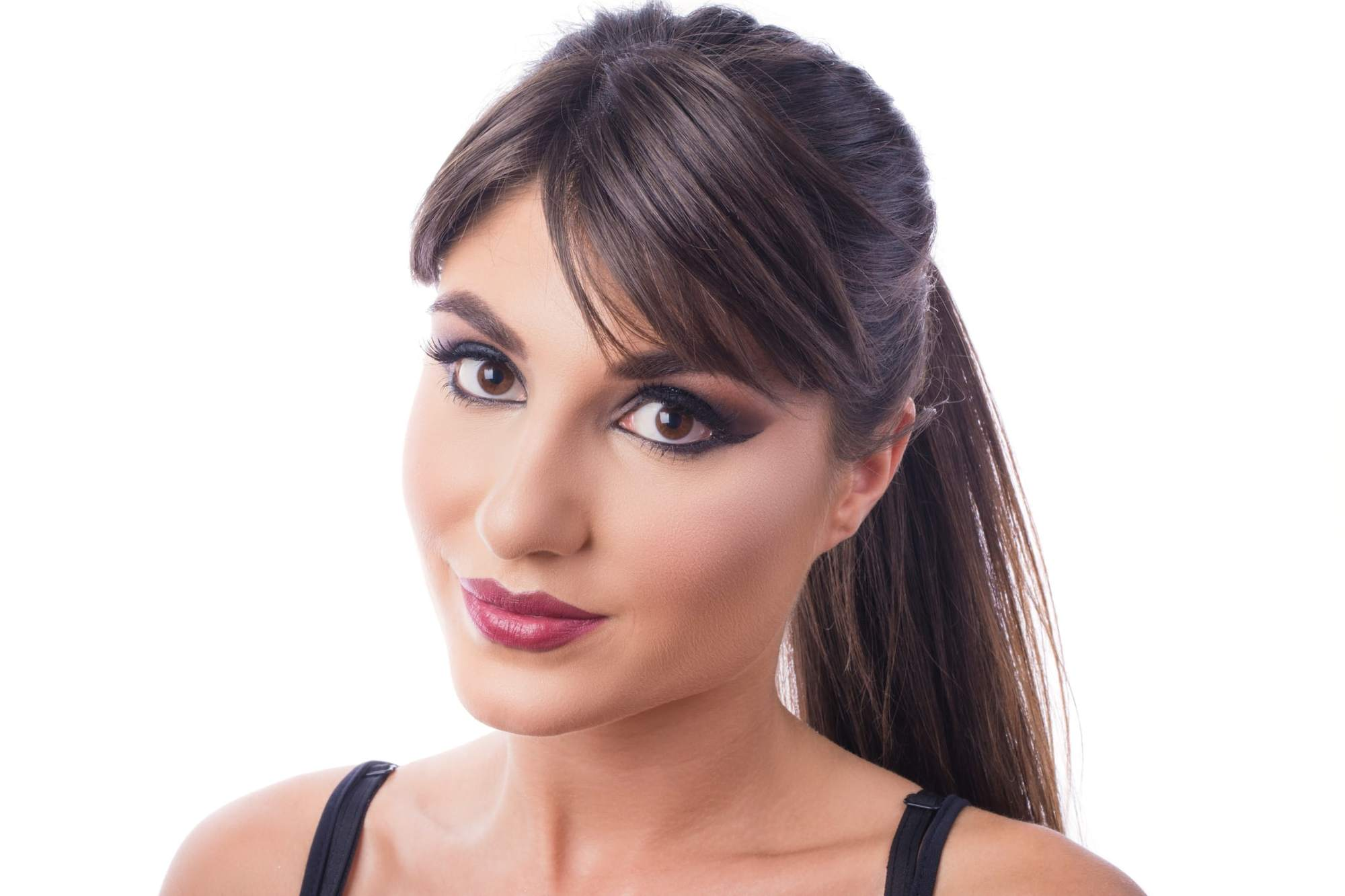 ponytail with bangs brushed to the side brunette
