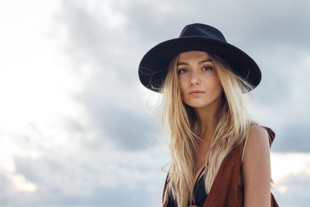 long hair with short layers light blonde black hat