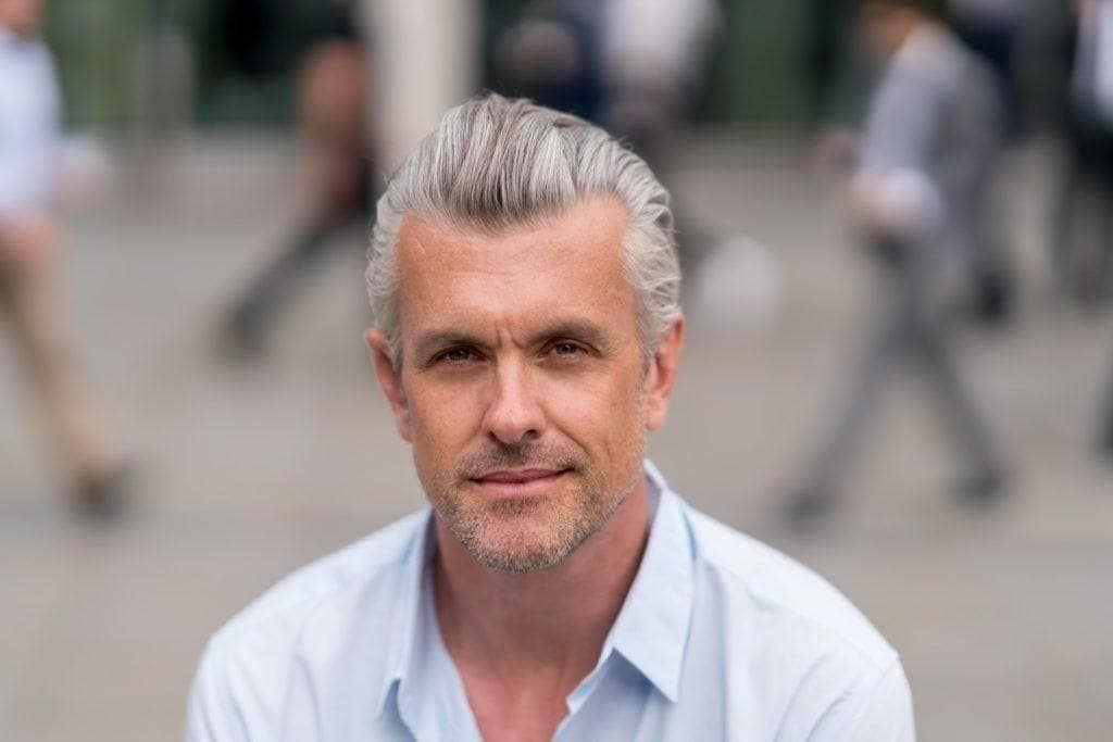 men grey hair styles 10 mens grey hairstyles that work with your lifestyle 3176 | mens grey hairstyles brushed back 1024x683