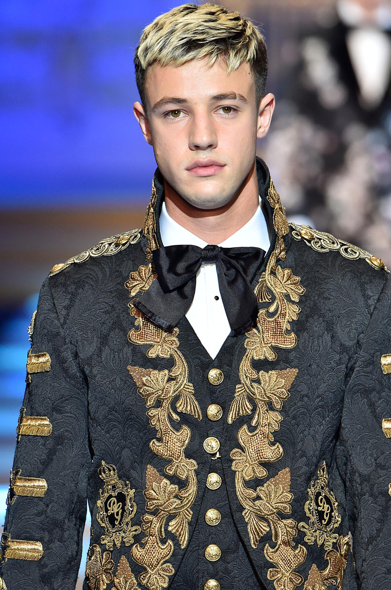 a male fashion model with short undercut on a runway