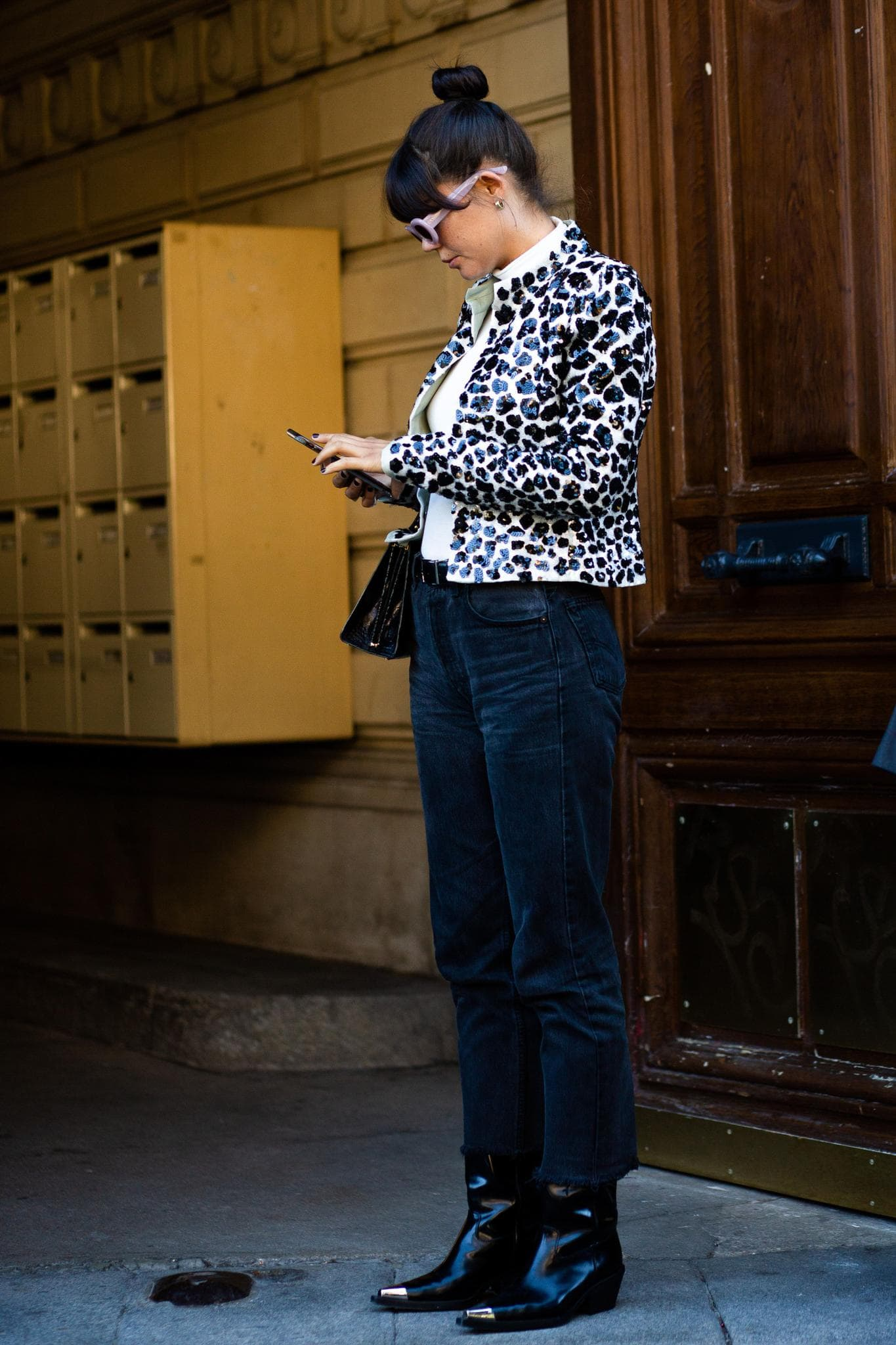 elevated messy bun Paris street style with bangs
