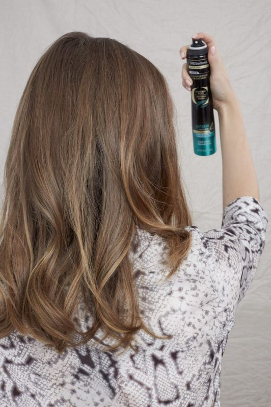 how to blow dry for big bouncy hair: hair spray