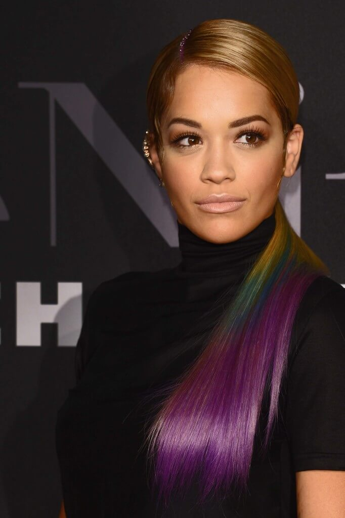 Rita Ora long straight rainbow dip-dyed hair in side ponytail with glitter along side parting