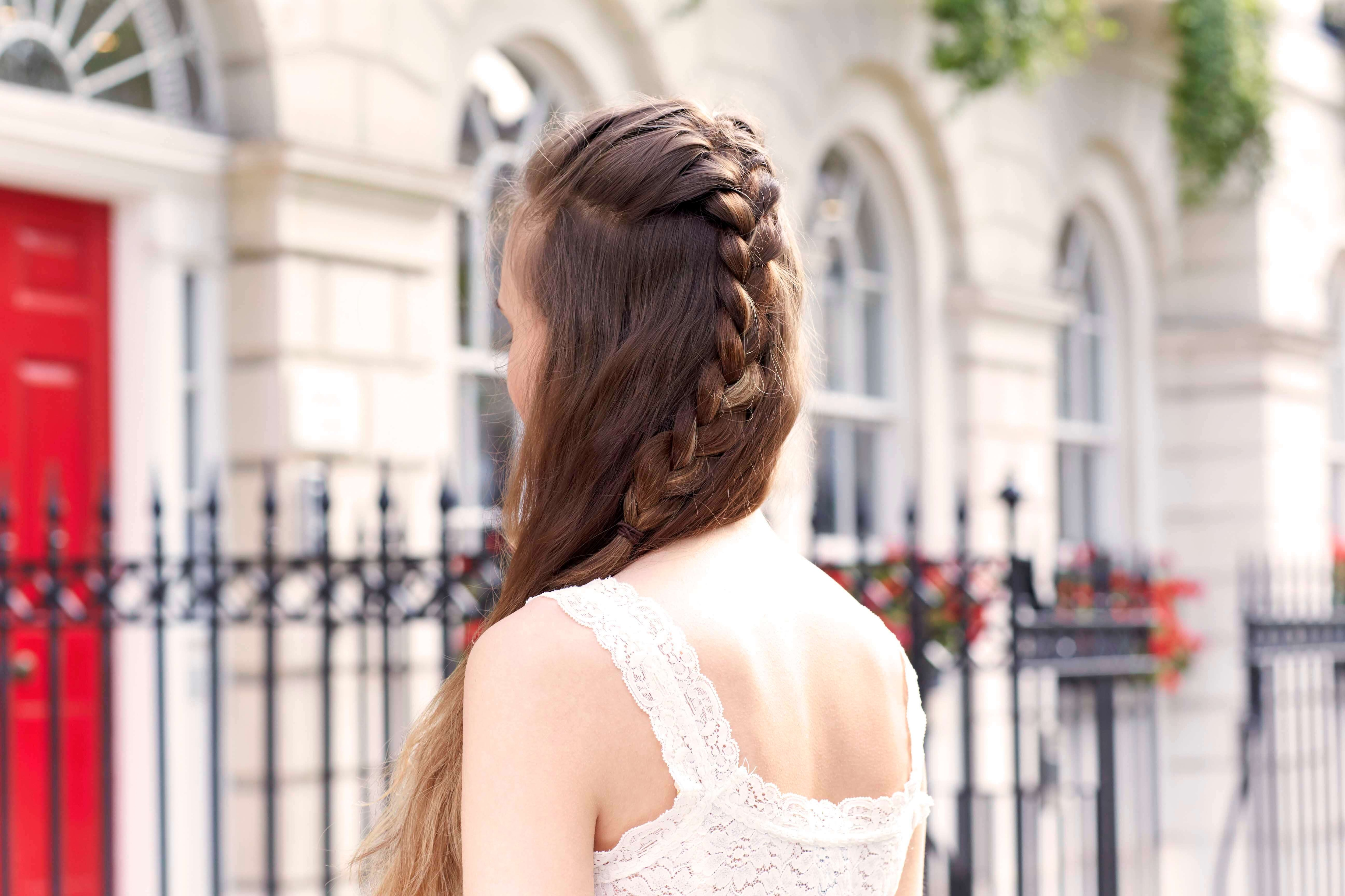 back view of model with light brown hair and a french plait middle braid