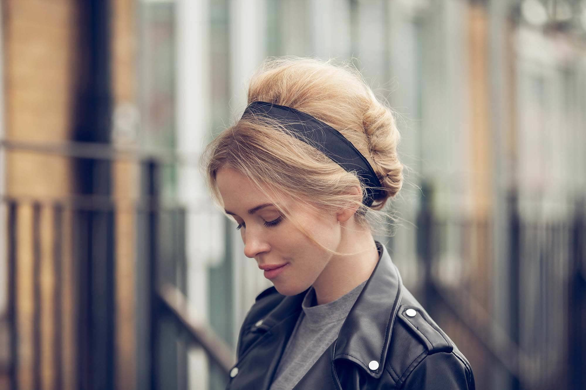 Vintage hairstyles: Blonde with a '60s Brigitte Bardot style bouffant beehive updo with a black headband