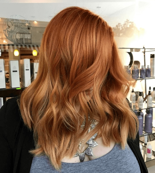 woman with loose waves and a subtle copper hair colour