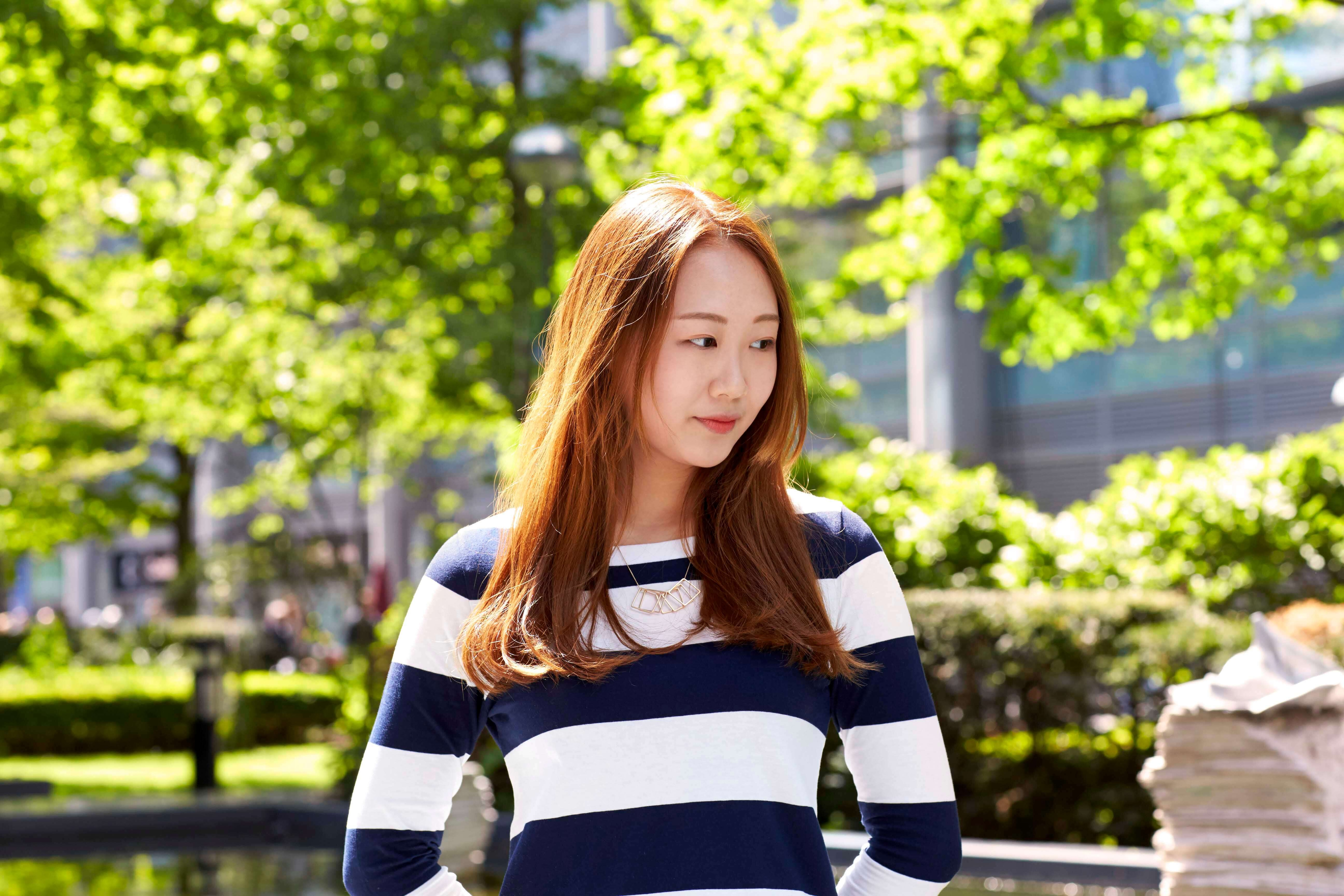 asian woman with long red brown hair
