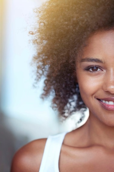 half shot of natural haired woman with afro curl hair