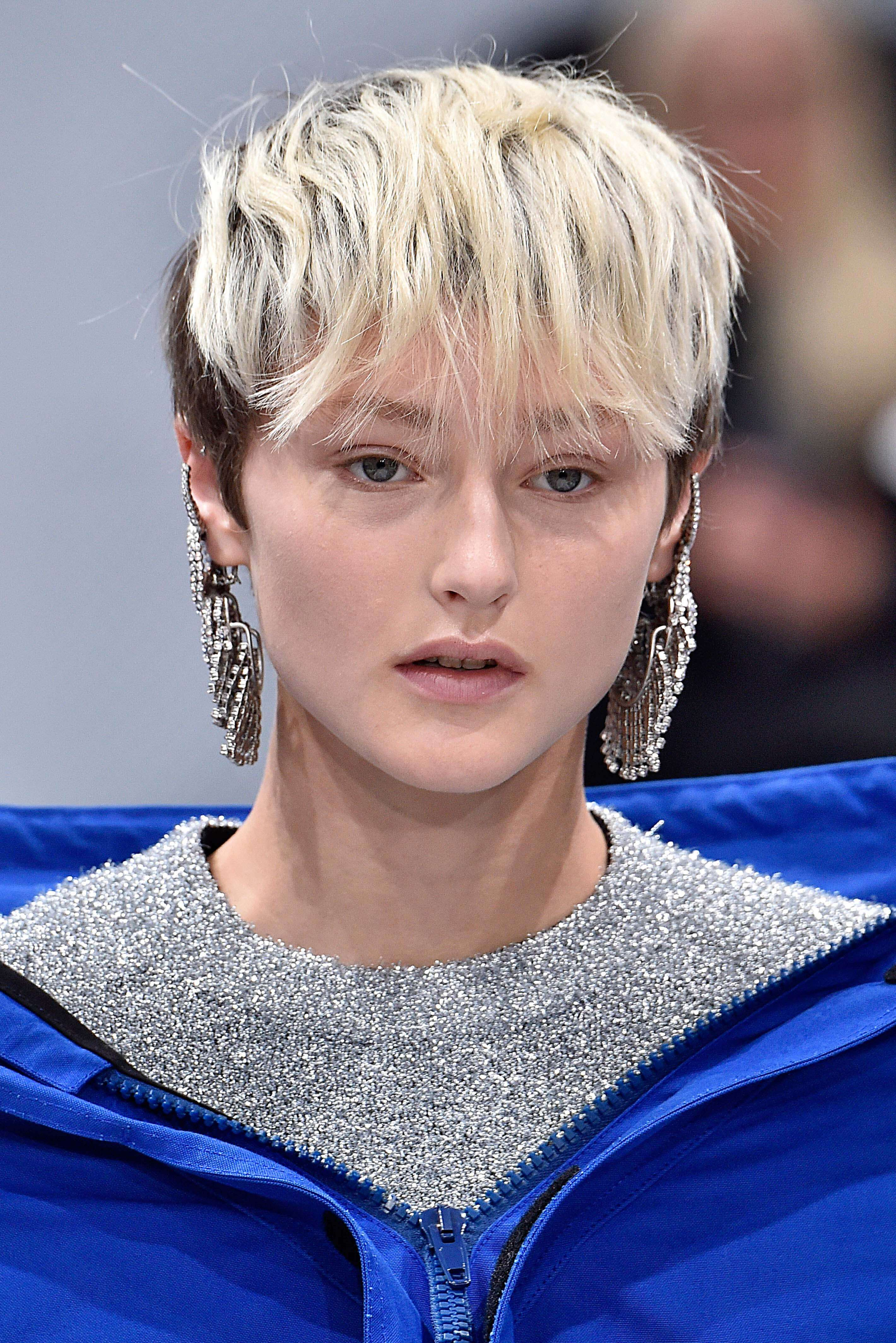 Very short hair styles: woman with a bleached pixie crop and undercut