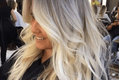 woman with ash blonde ombre hair