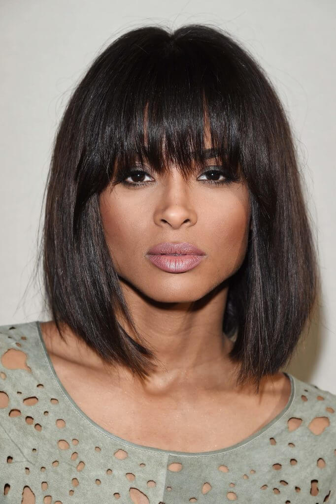 Close Up Shot Of Ciara With Wispy Blunt Bangs And Long Bob Hairstyle Wearing Green
