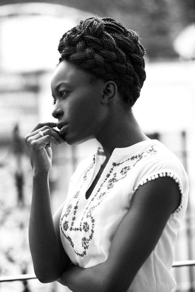 hairstyles for box braids: black and white image of a young black woman with a box braids plaited into an updo