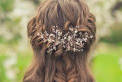 Brunette bride with beautiful wedding braid and hair accessory