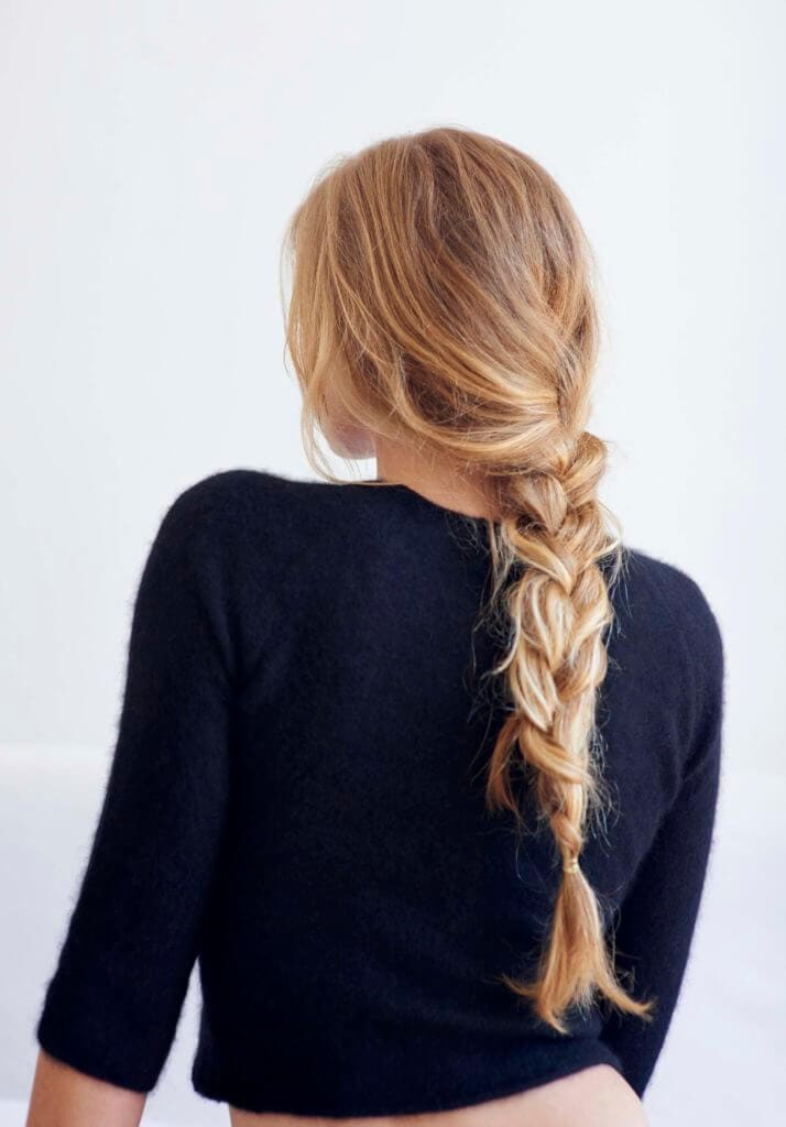 back view of a woman with a simple braided ponytail