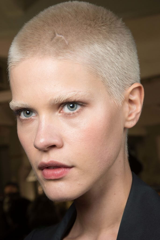 Very short haircuts for women: Bleach blonde model with a buzz cut