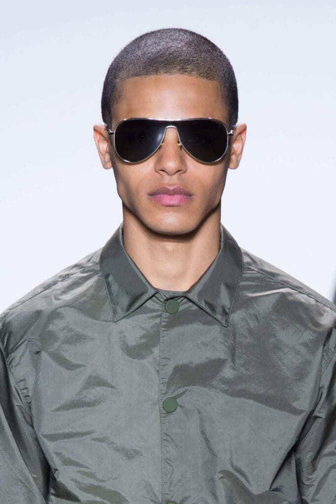 male fashion model with buzz haircut on the runway