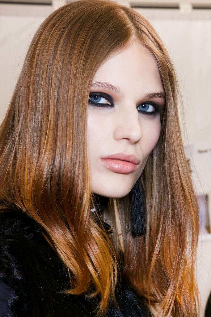 Model With Long Sleek Hair And A Balayage Copper At Elie Saab Ss16