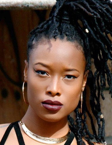 woman with dreadlocks tied in a high ponytail