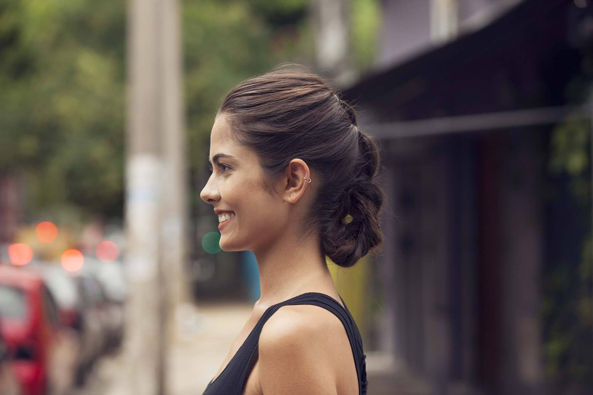 brunette model with a french braid tuck hairstyle