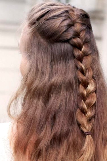 back view of a woman with light brown hair in a half-up french braid