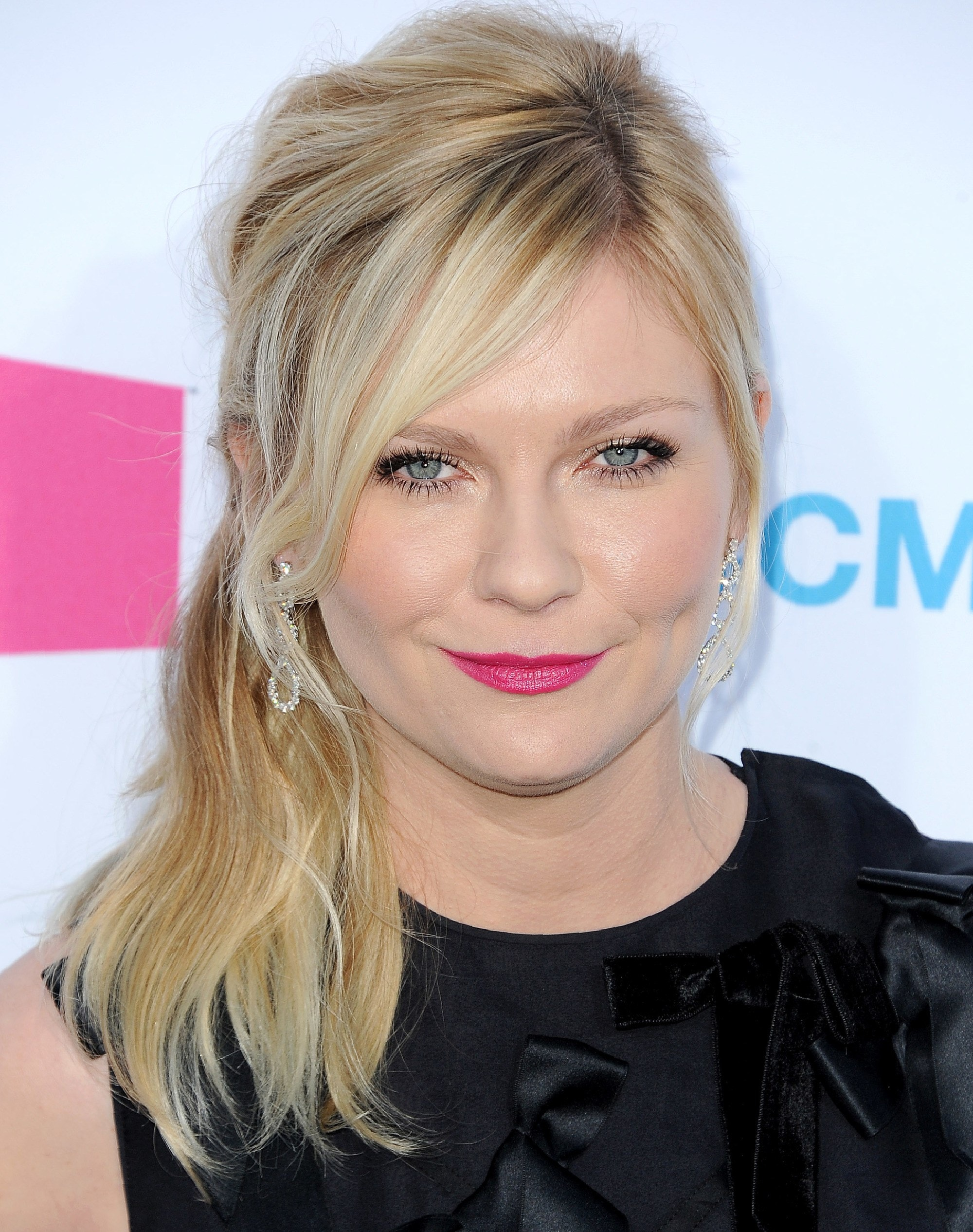 Kirsten Dunst With A Messy Side Ponytail And Bangs