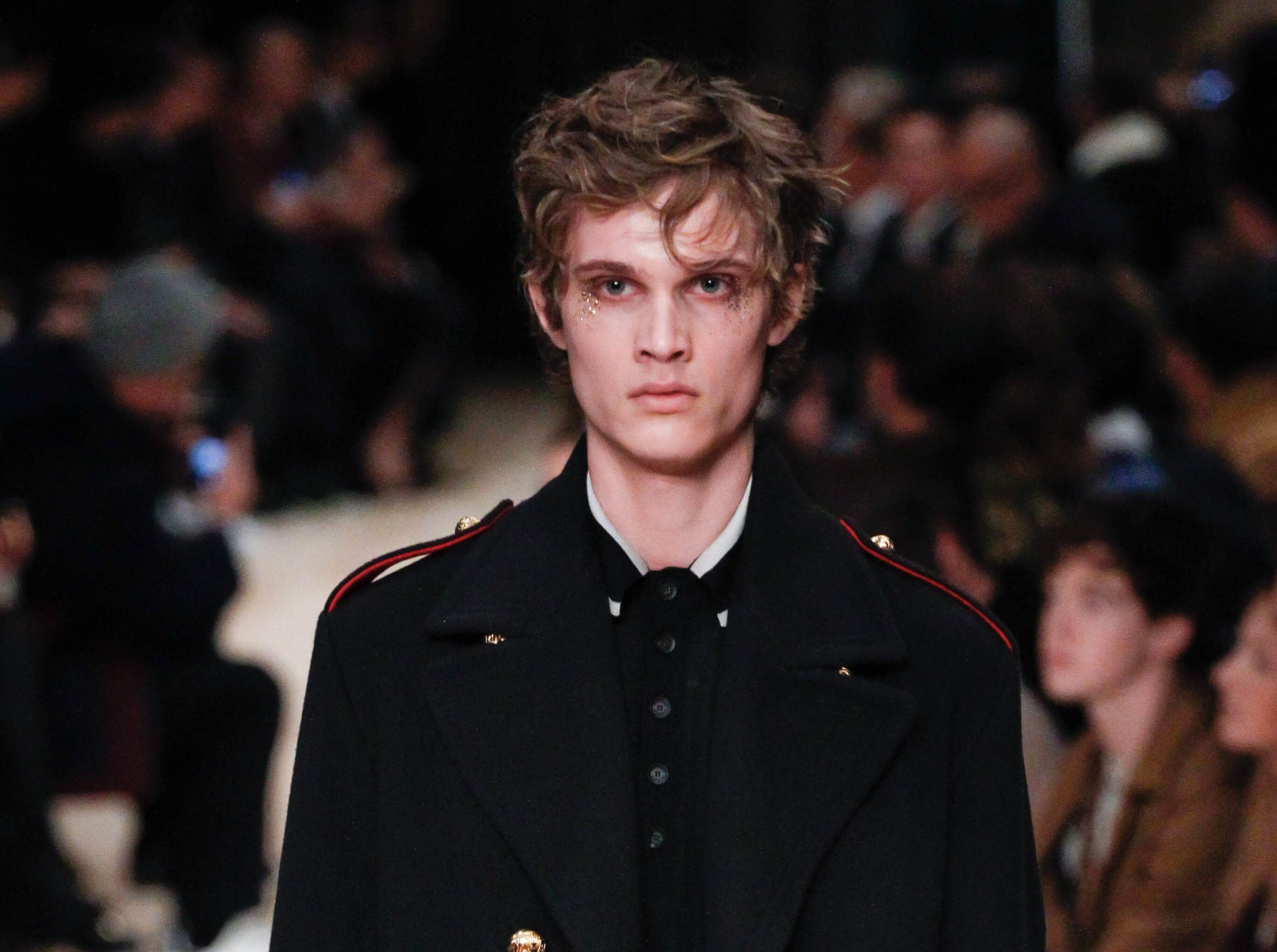 brown haired male runway model at fashion week with messy textured bed hair