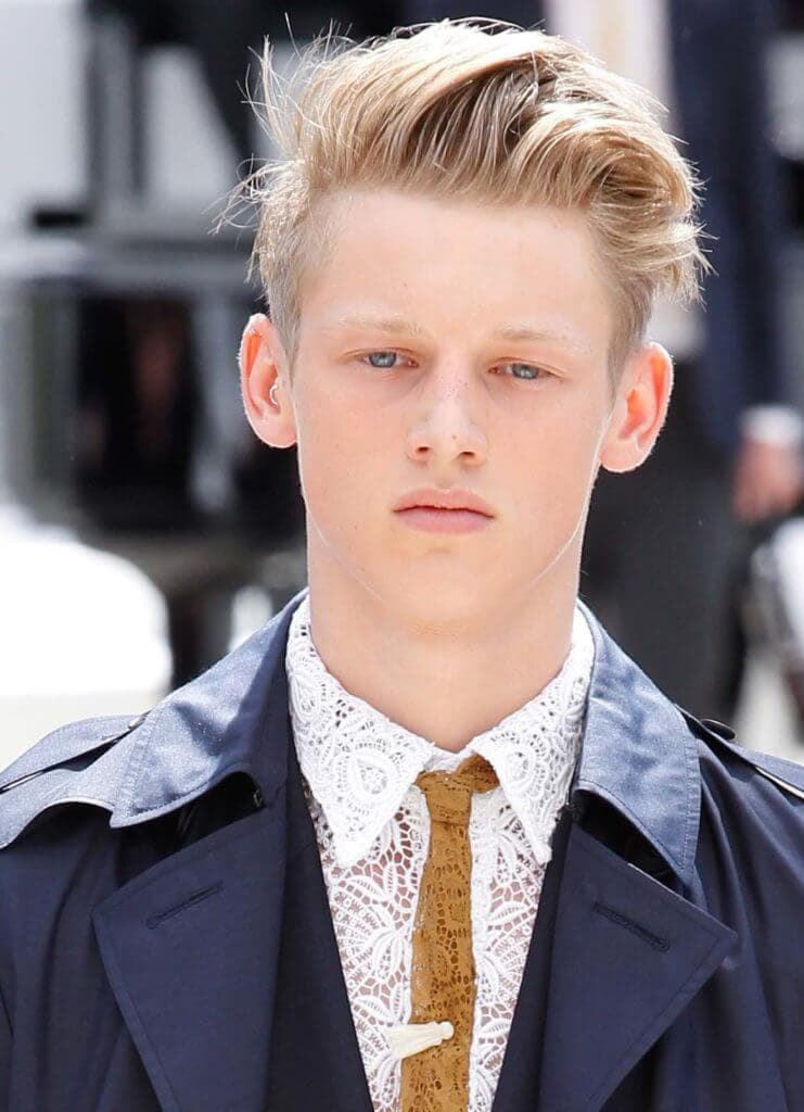 man with blonde hair worn in a messy quiff on the runway