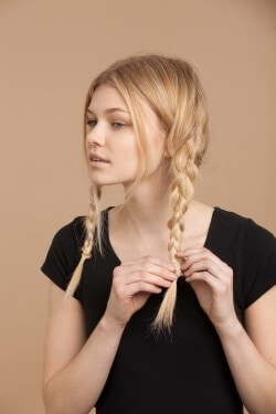 hairstyles for fine hair blonde girl creating braids