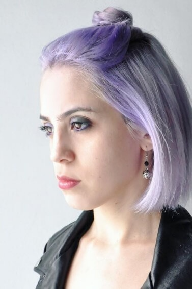 woman with a purple ombre topknot