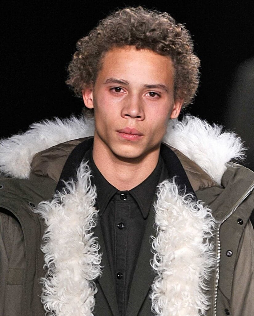 man on the runway with light brown blonde curls
