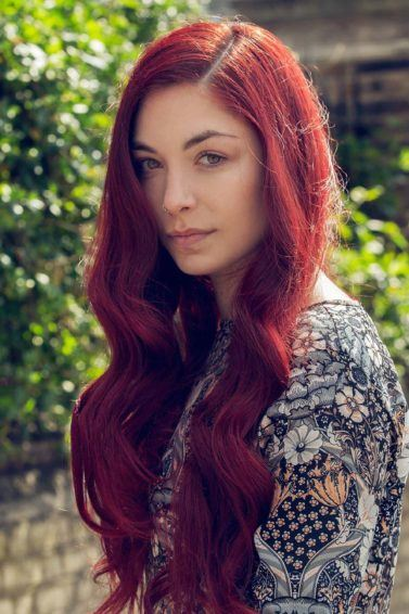 best shampoo for coloured hair: A young woman with long wavy red hair