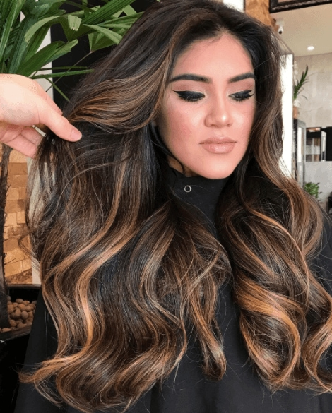 Dark balayage hair with caramels