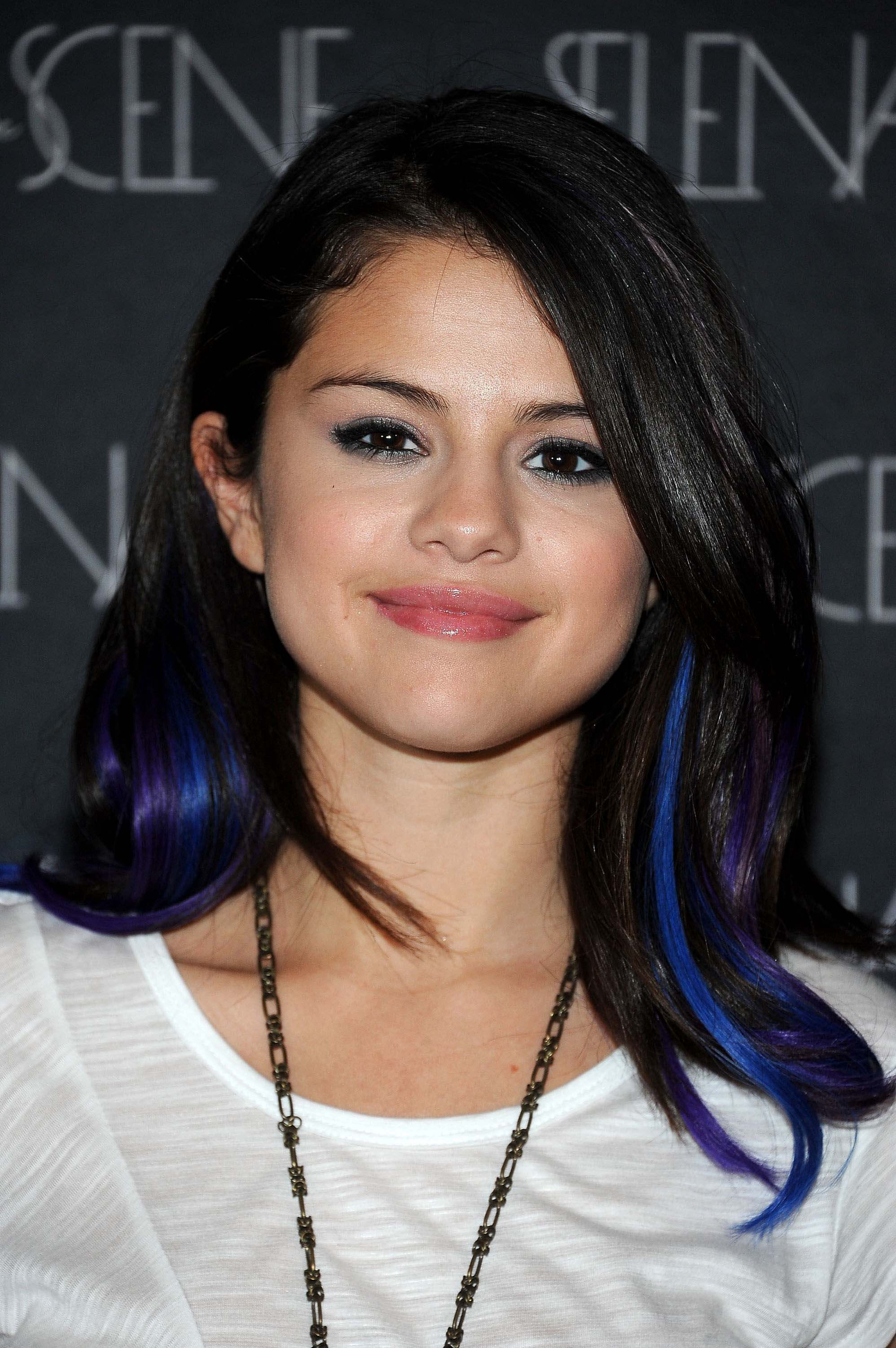 Blue hair 17 amazing a list looks you need to see selena gomez with dark hair and electric blue highlights pmusecretfo Choice Image