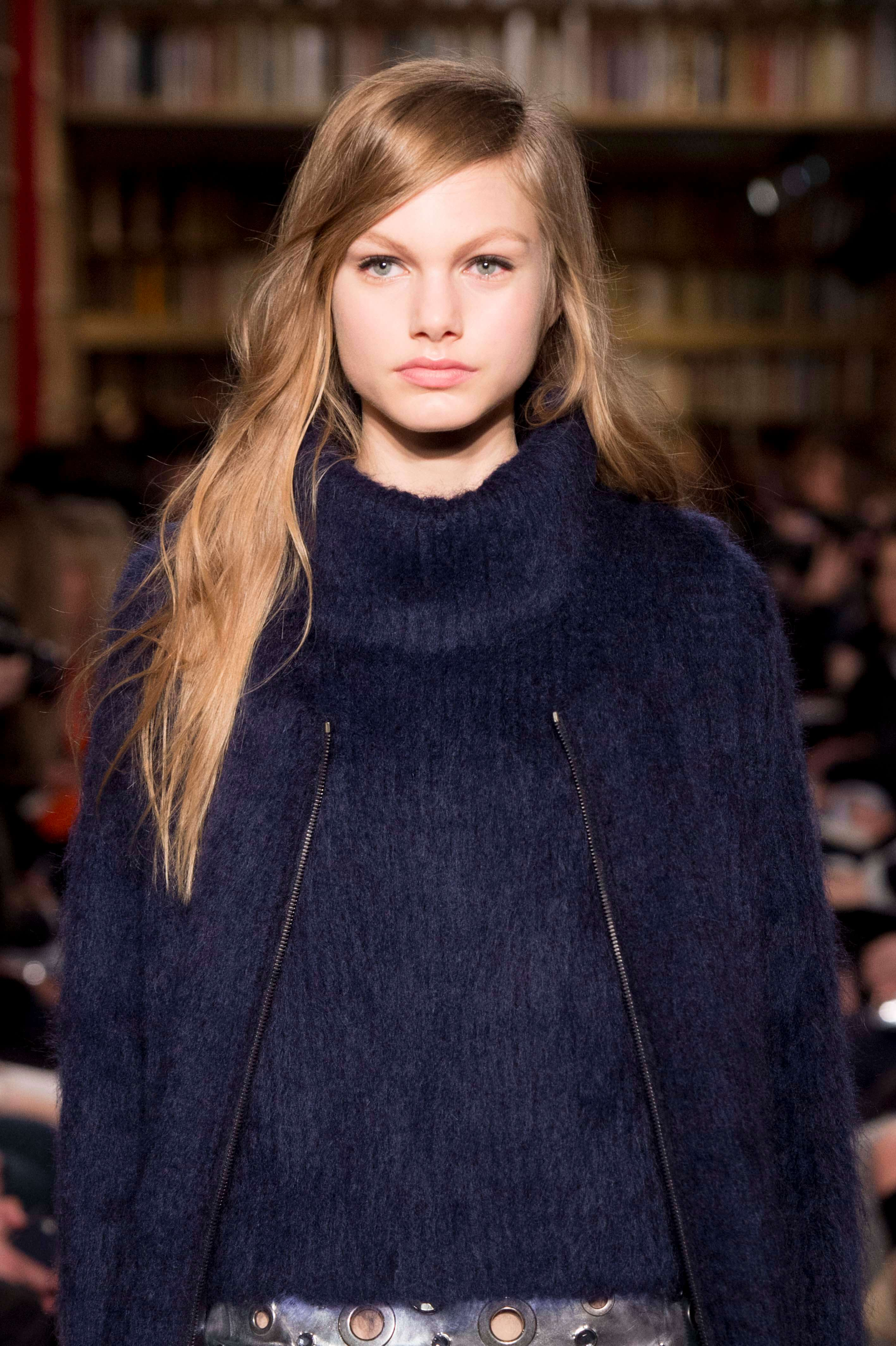 model with long blonde hair and a side swept fringe