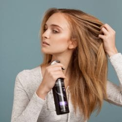 blonde-hair-spraying-tresemme-dry-shampoo
