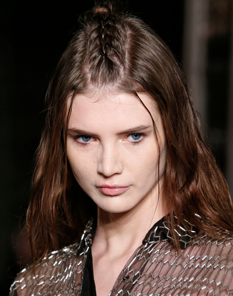 woman on the runway with light brown hair in a unicorn French braid