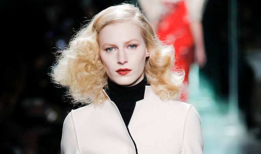 Blonde hair: Front facing view of a woman with golden-platinum-blonde hair and red lips.