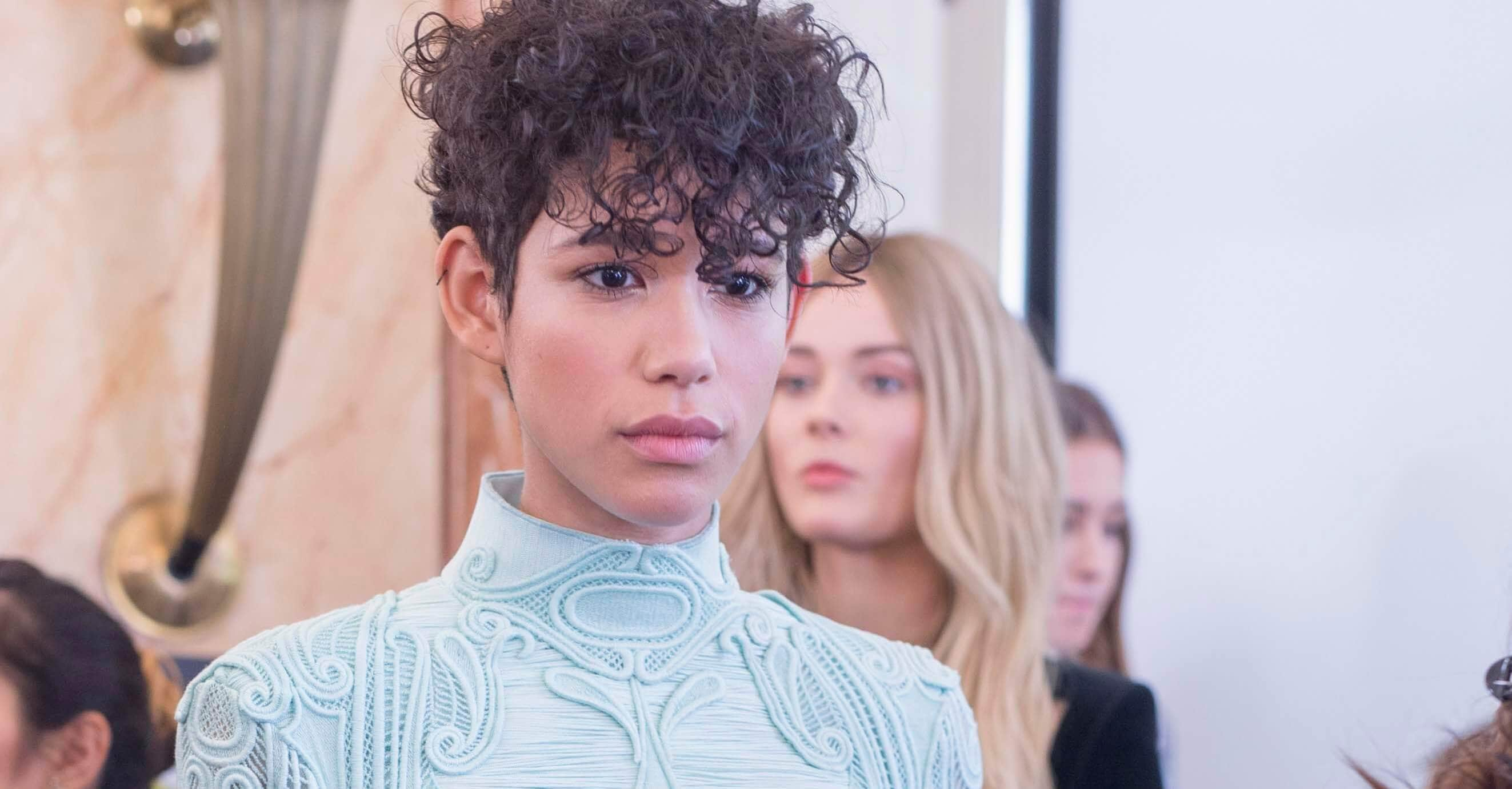 Very short haircut: Model with short curly cropped hair